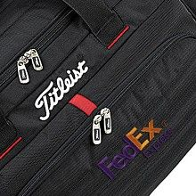 Embroidery with corporate logo on a wheeled duffel bag.