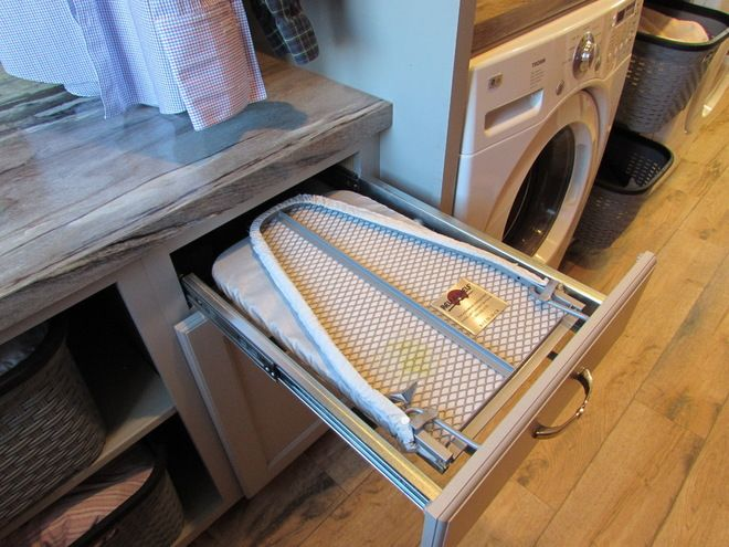 folding ironing board drawer  also get a pull out extra counter space for folding clothes? Although I'd rather fold clothes upstairs