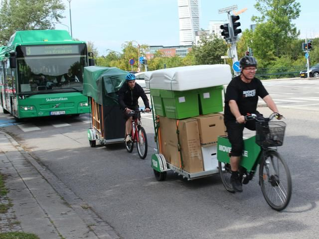 Move by Bike hauling a load on their 64AWD trailers | Furniture Movers | Bikes At Work