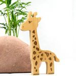 Georgi Giraffe is finally here. This beauty is 20 cm tall and made of European Beech wood. Laser engraved. It would look great standing on a shelf in a child's room. Georgi will be having some other African friends joining him soon. Decoration only. Can have child's name engraved on the back.