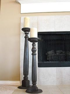 DIY candlesticks from table legs and round plaques. I like the idea of large candles by the fireplace...when the kids get bigger