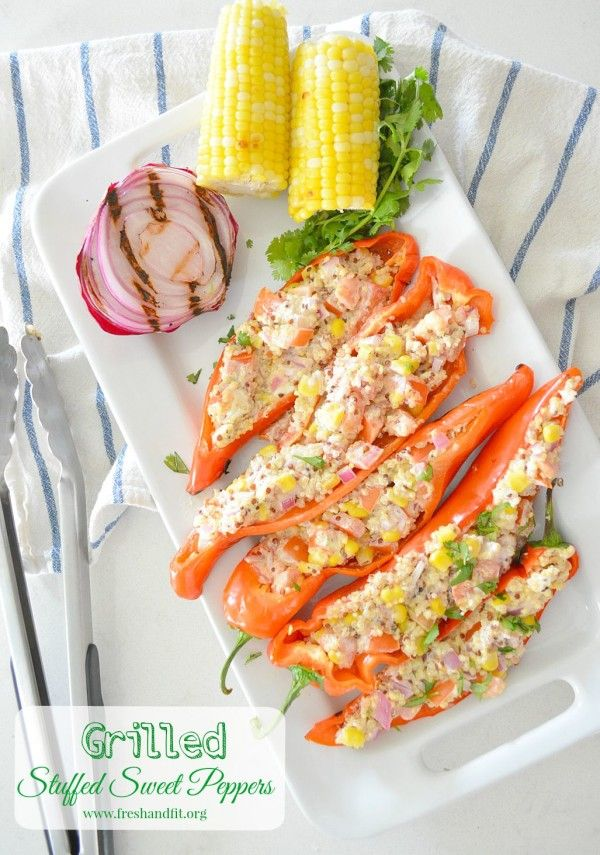 The perfect summertime side! Sweet Peppers stuffed with delicious quinoa, corn, and creamy goat cheese. #summerrecipes #healthysides #grilling #vegetarianrecipes