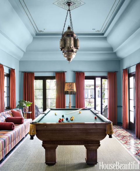 """""""When I painted the billiards room blue, it leapt to life,"""" Callaway says. Custom hue on walls and ceiling."""