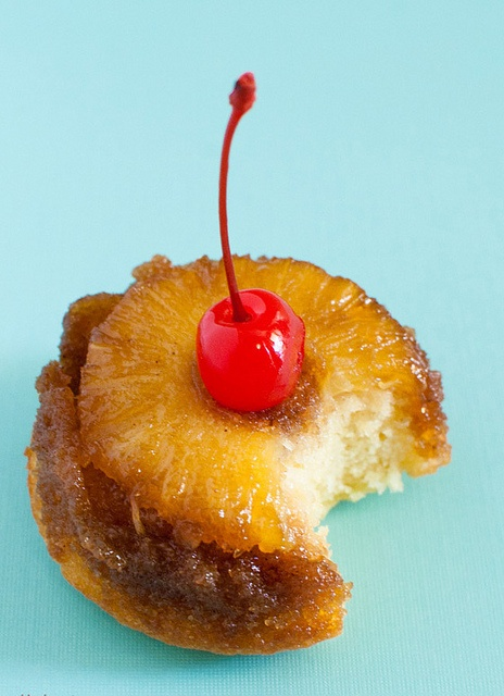 A delightful bite size way to recapture a classic retro dessert: Pineapple Upside Down Cupcakes. #cupcake #cake #pineapple #food #retro #vintage #dessert #baking #upside_down