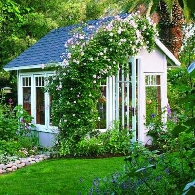 cottage-y cute - love the greenery over the shed!