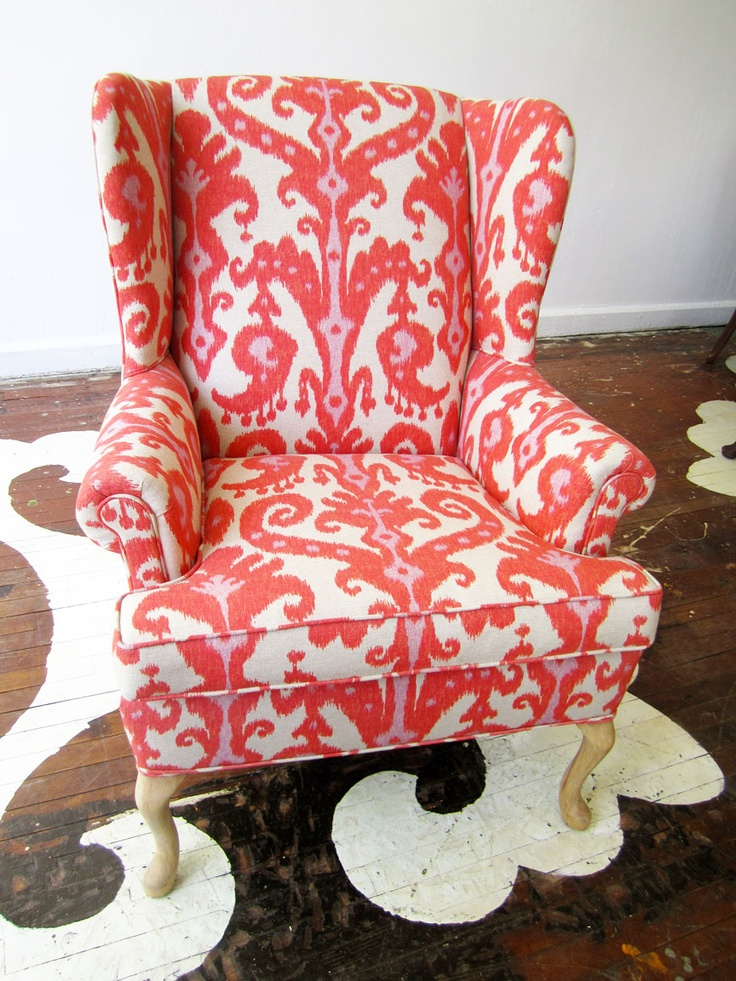 We stripped this chair down to the frame and completely re-built it from the inside out. We sanded the old finish off the legs which somehow makes the chair feel so modern. The chair is upholstered, with all new foam and down cushioning, in a heavy-weight linen printed in a pink and red Ikat pattern.