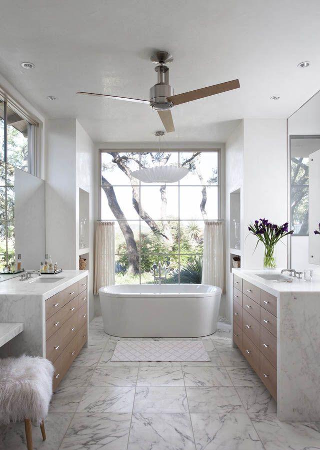 stunning white marble bathroom home tour tasteful and timeless in austin fur stool modern bathtub marble floor