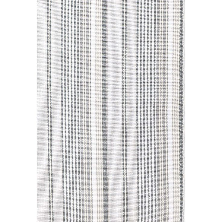 With its classic ticking stripes in varied shades of grey, and crafted of eco-friendly materials, this versatile, durable, and washable indoor/outdoor area rug makes the grade. Gradation Ticking also available in woven cotton.