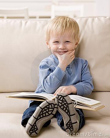 Google Image Result for http://www.dreamstime.com/boy-enjoying-reading-a-book-thumb6602676.jpg