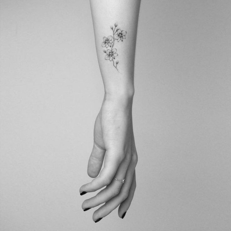 "smalltattoosco: ""Hand poked orchid tattoo on the wrist. Tattoo artist: Lara M. J. """