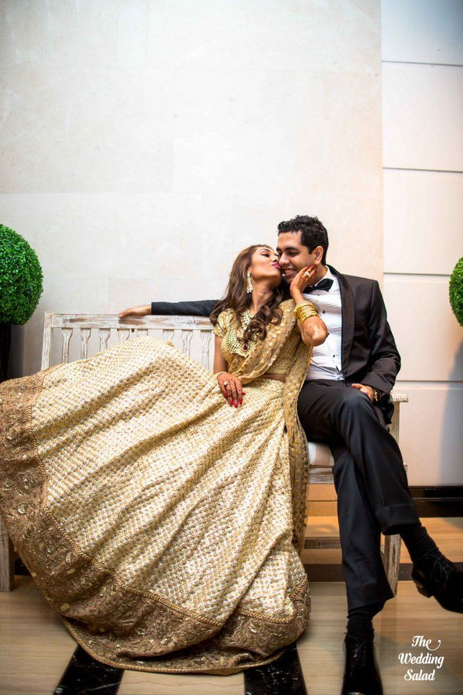 A bride in a gold sequence Sabyasachi lehenga, shot by wedding photographers - The Wedding Salad