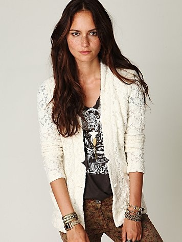 """Lace Blazer  Super soft lace blazer with two front pockets and one-button placket. Featured smocked band in the back. Unlined.    *60% cotton, 40% nylon  *Machine Wash  *Import    Measurements for Size Small:  Length: 30""""  Bust: 19 3/4"""" (measured straight across the back only)  Waist: 19 1/4"""" extended (measured straight across the back only)    $148"""