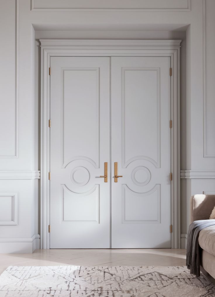 Two Metrie Fashion Forward Collection #doors were used to create a glamorous double-door #entry. #livingroom #moulding #trim #trimwork