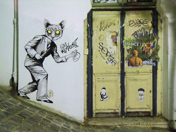 Suriani: Animal-human hybrid stickers invading Parisian streets and a gallery