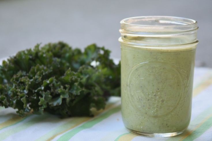Green smoothie with banana, almond butter and greens