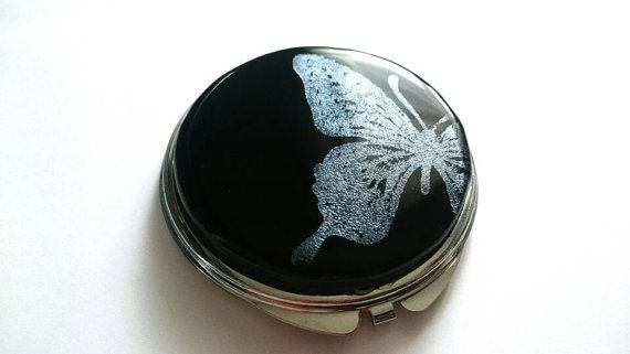 Check out this item in my Etsy shop https://www.etsy.com/listing/480037147/pocket-mirror-with-silver-butterfly-hand