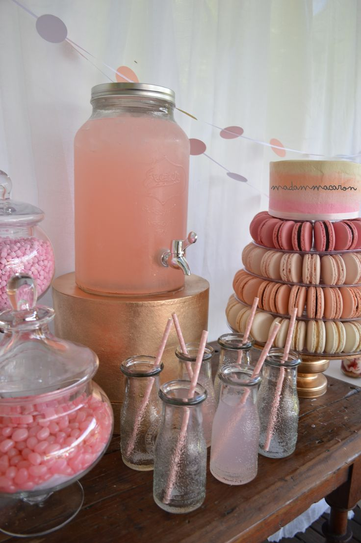 Pink, white, peach and gold dessert table! Drink dispenser with pink lemonade, lolly buffet and macaron stand with cake on top!