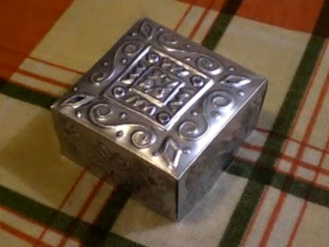 This shiny little box was made from a soda can. You don't need much to pull this off; an aluminum can, sand paper, scissors, a ballpoint pen, a straight edge, and some time. The embossing is done w...
