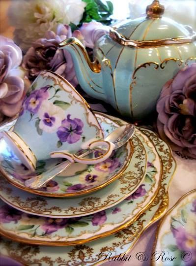 Vintage pansy pattern service, in pale aqua and gold gilding... Nothing quite like a china tea cup and saucer!