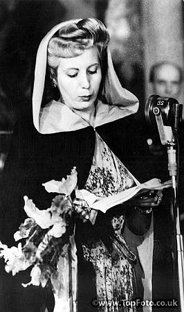 Senora Eva Peron, film star wife of the Argentine President ,reads an address of thanks after receiving a gift in Rome. July 1947