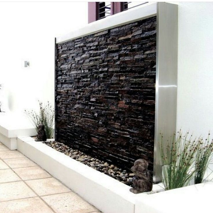 Water feature, along wall on both side of entrance.