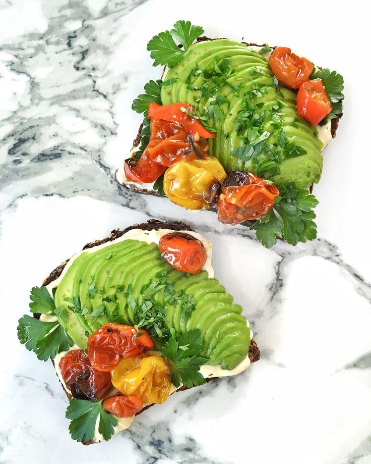 Avocado toast, hummus, parsley and slow roasted tomatoes