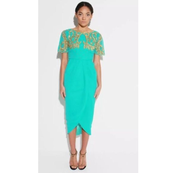 VIRGOS LOUNGE MID-calf embellished dress sz 2 UK6 VIRGOS LOUNGE EMBELLISHED size 2 brand NEW + TAGS  GORGEOUS TURQUOISE MIDI DRESS  WITH STUNNING STATEMENT EMBELLISH TO THE BODICE  FRONT WRAP SPLIT DESIGN AND A V NECK A striking party dress from Virgos Lounge that taps into this season's trend Combine with heels for a breathtaking look Virgos Lounge Dresses Midi