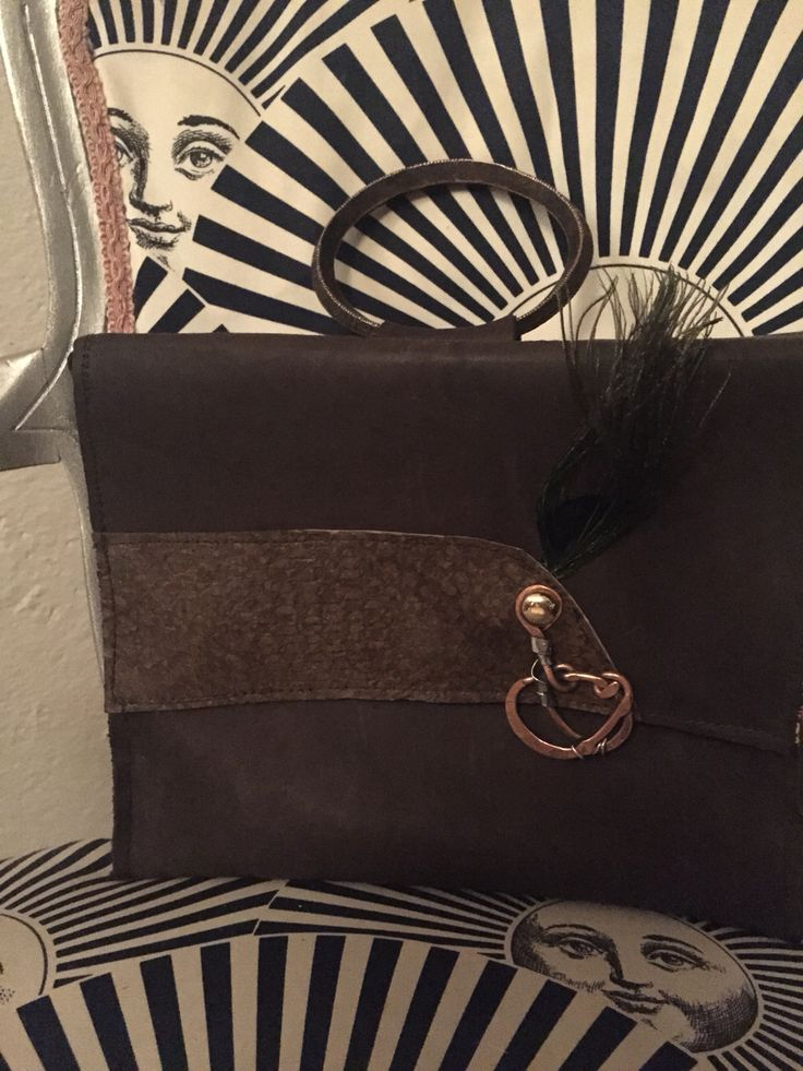 Leather bag. Handcrafted wirh unique accessories. Handel Is made with an antique bracelet.