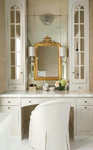 From Traditional Home magazine ~ Gilt mirror in this lovely Vanity Area of bathroom.