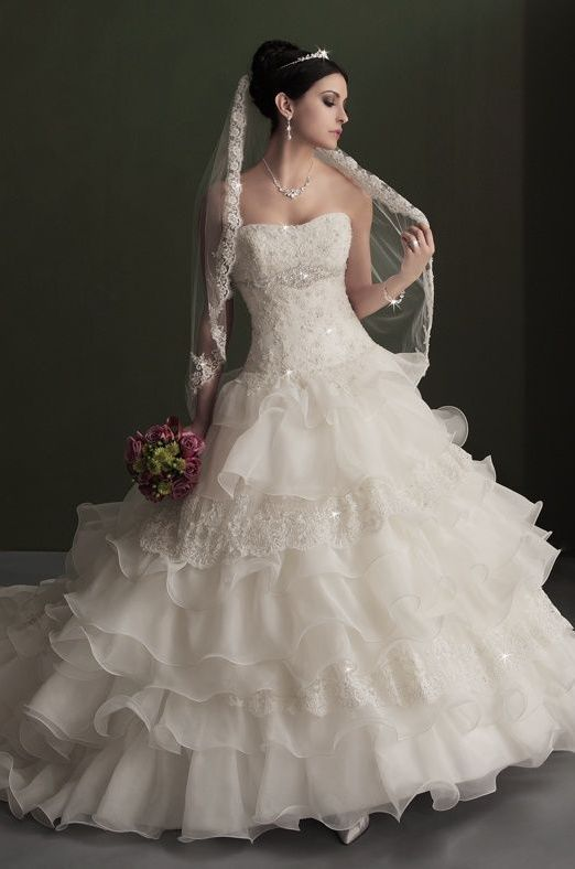 Karelina Sposa Exclusive Wedding Dress love it with the veil and everything!