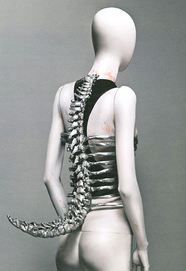 Alexander McQueen - saw this piece in real life. McQueen said that the lower back is the sexiest part on any person. You can see this focus come out his work.