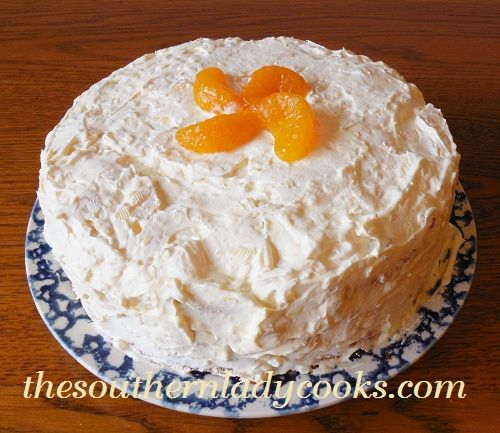 Mandarin Orange Cake Scratch: CAKE: 2 - 1/2 c GF flour, 2 1/4 tsp baking powder, 3/4 c butter, room temperature 2 1/2 c sugar, divided 4 eggs, 11 oz can mandarin oranges, undrained. FROSTING: 2 c whipping cream, 1 box 3.4 ounce (4-serving size) box instant vanilla pudding, 1 8-ounce can crushed pineapple, undrained
