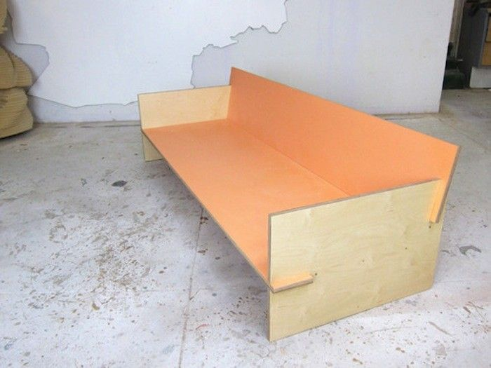 Looks like this bench/sofa could be mobile - Waka Waka Painted Plywood Bench