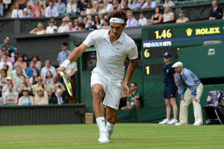 Roger Federer hits a one handed backhand to Fabio Fognini. - Matthias Hangst/AELTC
