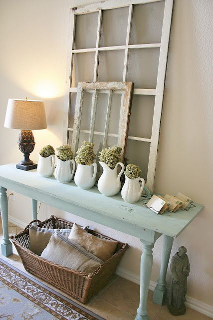 Love this color. Console table with windows propped above; practical basket storage on shelf below. Cute! I esp. like the table...add some turquoise to make it pop!