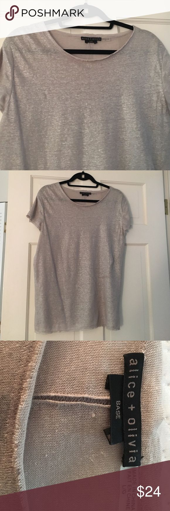 Alice and Olivera silk silver metallic tee Dressy tee shirt. Linen and silk metallic silver tee. Dress up or down! Perfect for layering Alice + Olivia Tops Tees - Short Sleeve