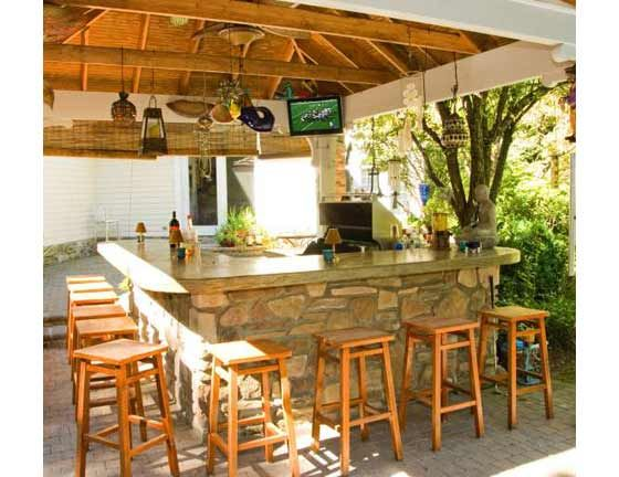 Backyard bar plans though modest in size this outdoor for Outdoor kitchen bar plans