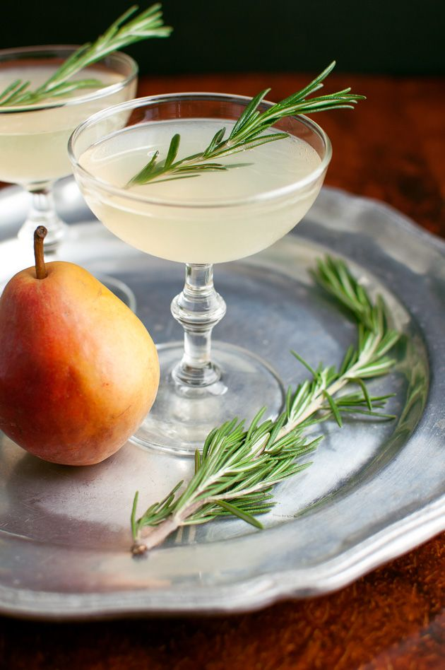 Pear Rosemary Cocktail - Rosemary infused simple syrup and pear vodka make the perfect autumn cocktail. | tamingofthespoon.com