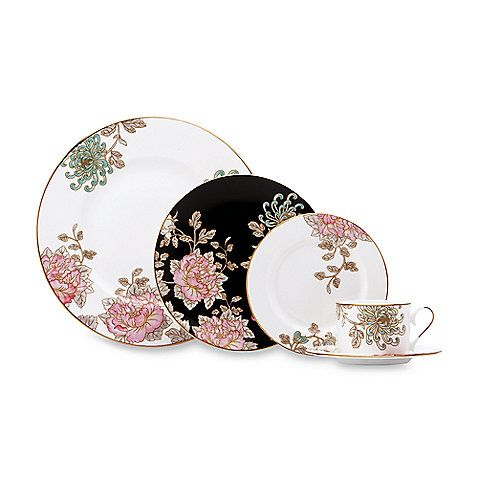 Designed for Lenox by the renowned fashion house of Marchesa, the exquisite Painted Camellia Dinnerware features vintage florals in soft aqua and pink-coral hues. Each elegant piece is crafted of fine bone china and rimmed in 24K gold.