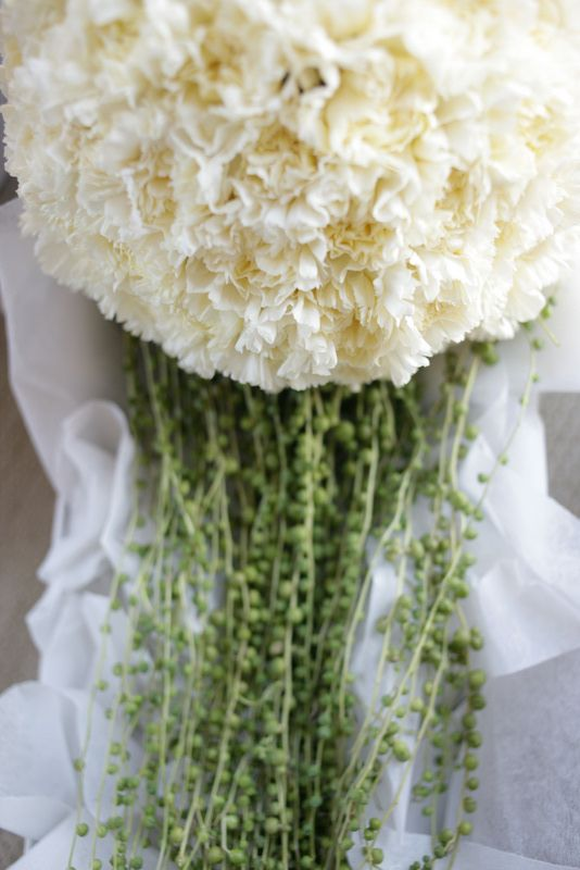 Sphere of White Sim Carnations with trailing string of pearls