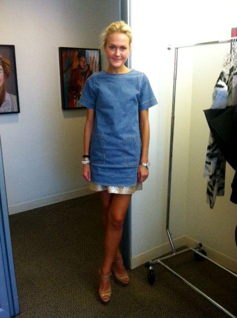 Fashion Market Editor Mary Kate Steinmiller is wearing a Stella McCartney  Kids denim dress as a top over a sparkly Giambattista Valli skirt.