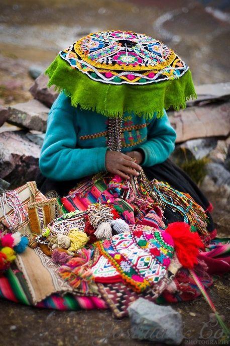 Quechua girl making and selling textiles, Mount Ausangate, Cuzco, Peru by Joshua Lawton
