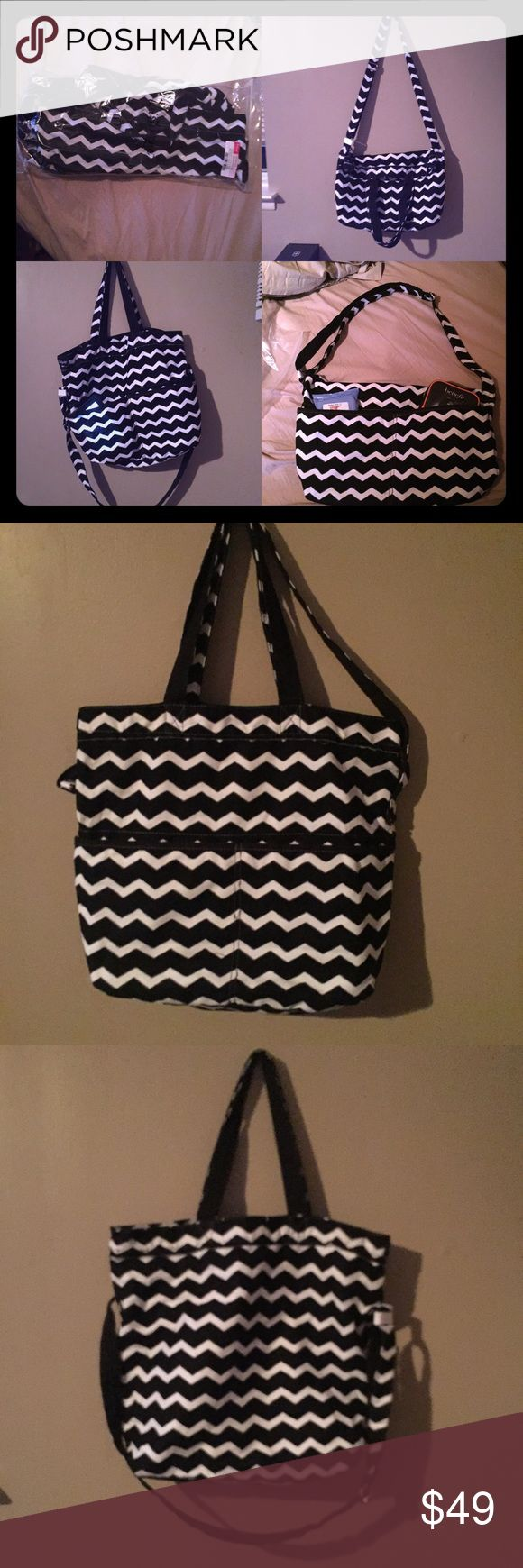 31 Retro Metro Foldover Black Chevron 1-HR SALE! Thirty-One Retro Metro Foldover Crossbody in Black Chevron. This item is RETIRED ! Brand new in original packaging with tags only taken out of packaging to take photos. There's a million and one ways to wear this versatile bag with its handles and adjustable long shoulder strap. Has 2 front pockets and inside zipper compartment Thirty One Bags Crossbody Bags
