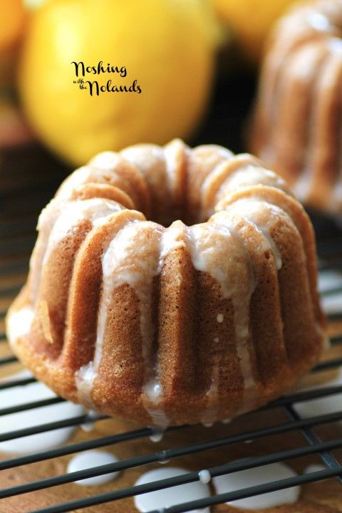 Mini Lemon Spring Bundts by Noshing With The Nolands - These little mini bundt cakes are adorable and perfect for portion control. You can even serve them in cupcake wrappers.