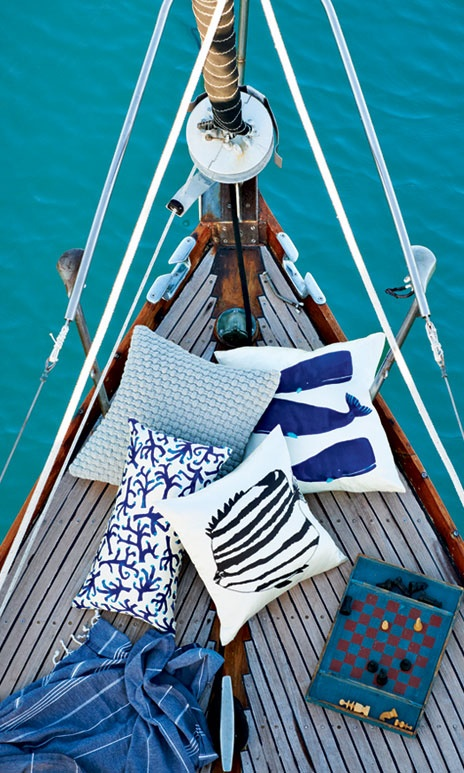 The fact that the checkers aren't blowing and the blue and white nautical pillows tell me this sail boat must be in irons...no wind at all. Sometimes that's the most relaxing time of a sail.