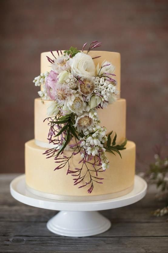 Pale yellow tiered wedding cake with gorgeous flowers #wedding #weddingcake #cake #flowers #rusticchic