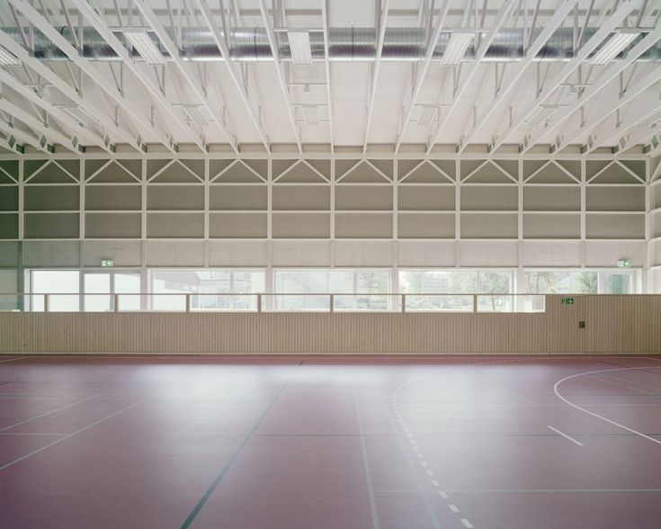 Wooden trusses pattern walls of sports hall by Florian Fischer features