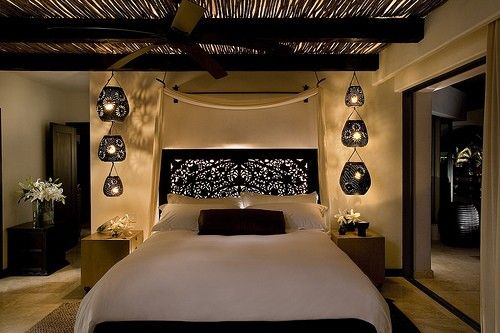 Bedroom, asian style, lamps, black and white.  Also, like headboard and draped fabric.