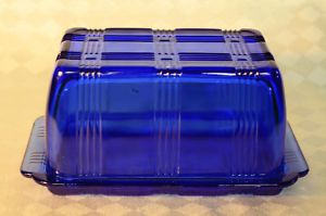 Cobalt Blue Depression Glass Butter Dish -- I have this exact dish in clear glass. It was my great-grandfather's. Not sure but it could be from before the Depression.