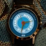 The Target Obama Watch was designed by A. Nonymous, a well-known graphic designer who also designed the Forward.  Obama Watch. You van find it and 9 other watches from the 2012 Obama Watch Collection at http://obamawatches.com